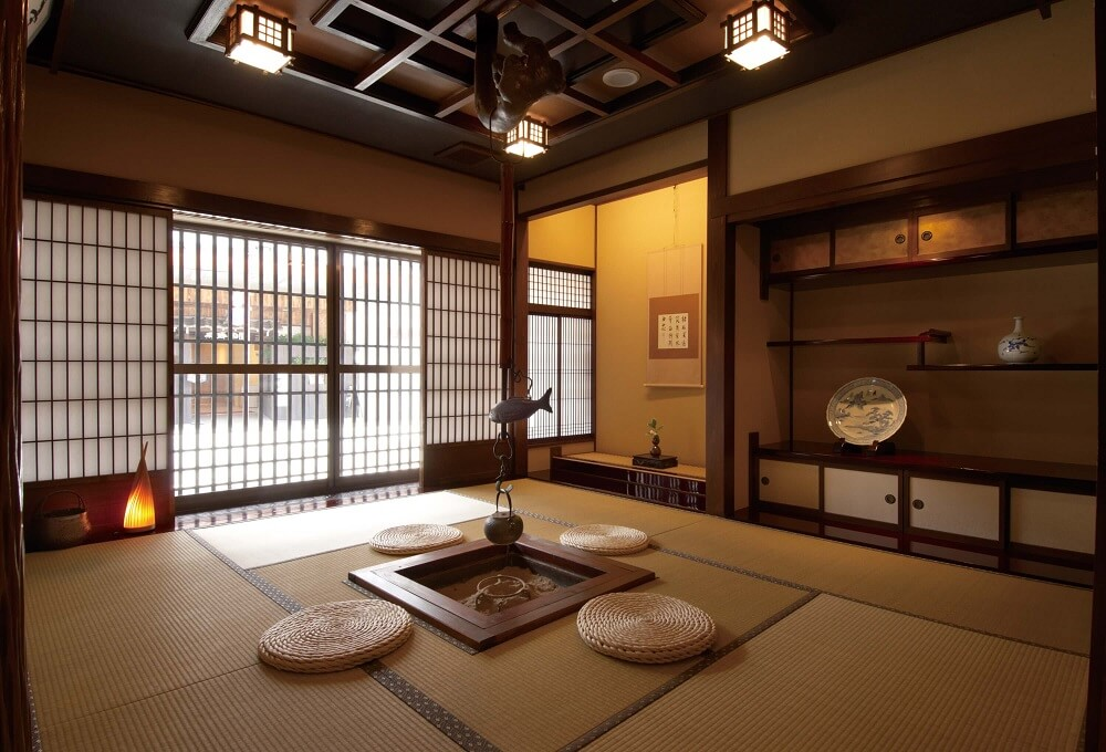 Traditional Japanese ryokan room with tatami mats and paper screen doors