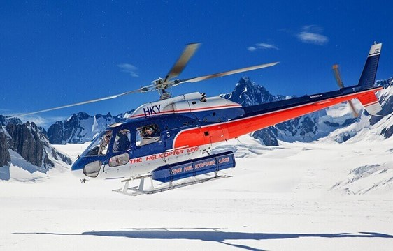Helicopter landing on snowy mountain in August in New Zealand