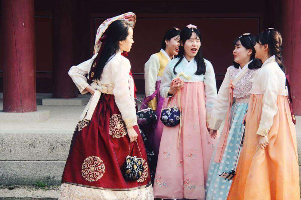 korean women dressed in traditional hanbok for solleal korean new year