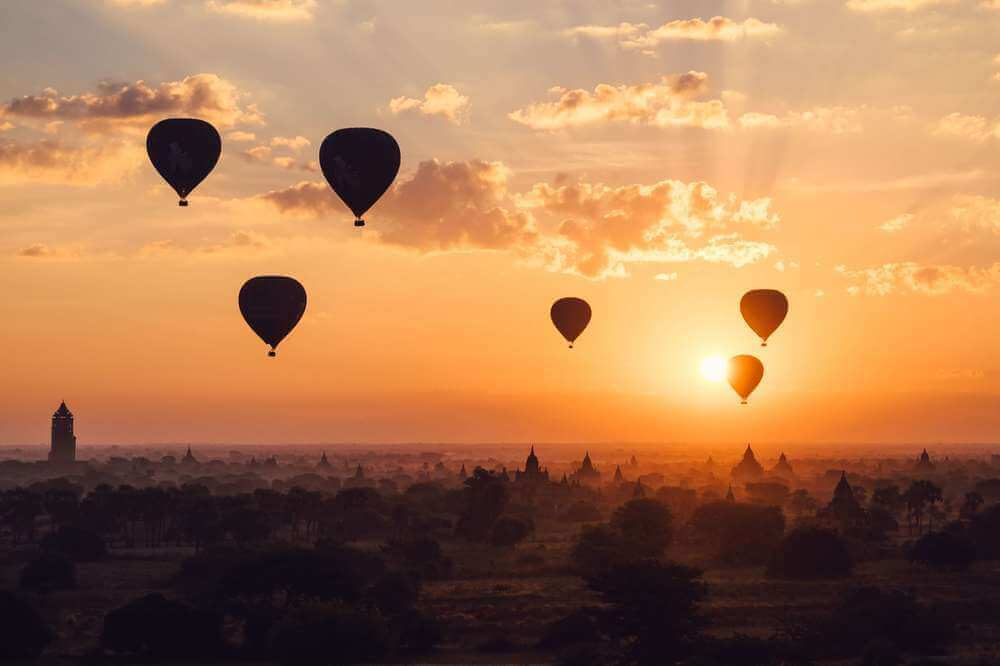 Hot air balloons rising over the temples of Bagan in Myanmar