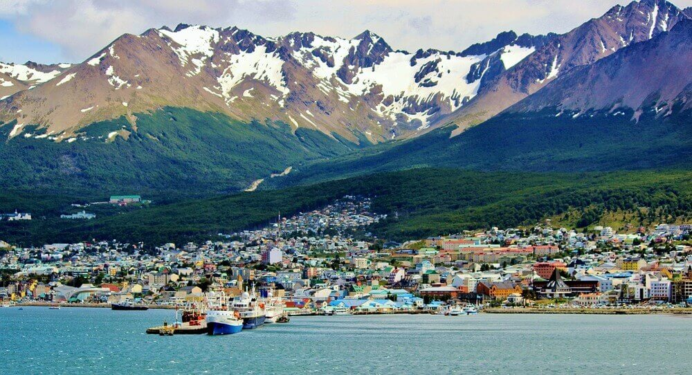 The town of Ushuaia surrounded by snow-capped mountains in Argentina