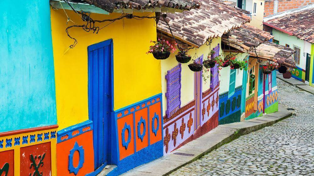 colourful buildings lining the cobblestone streets of colombia