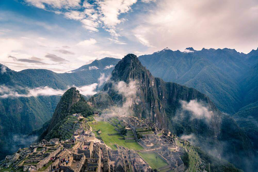 machu picchu rising through the misty clouds