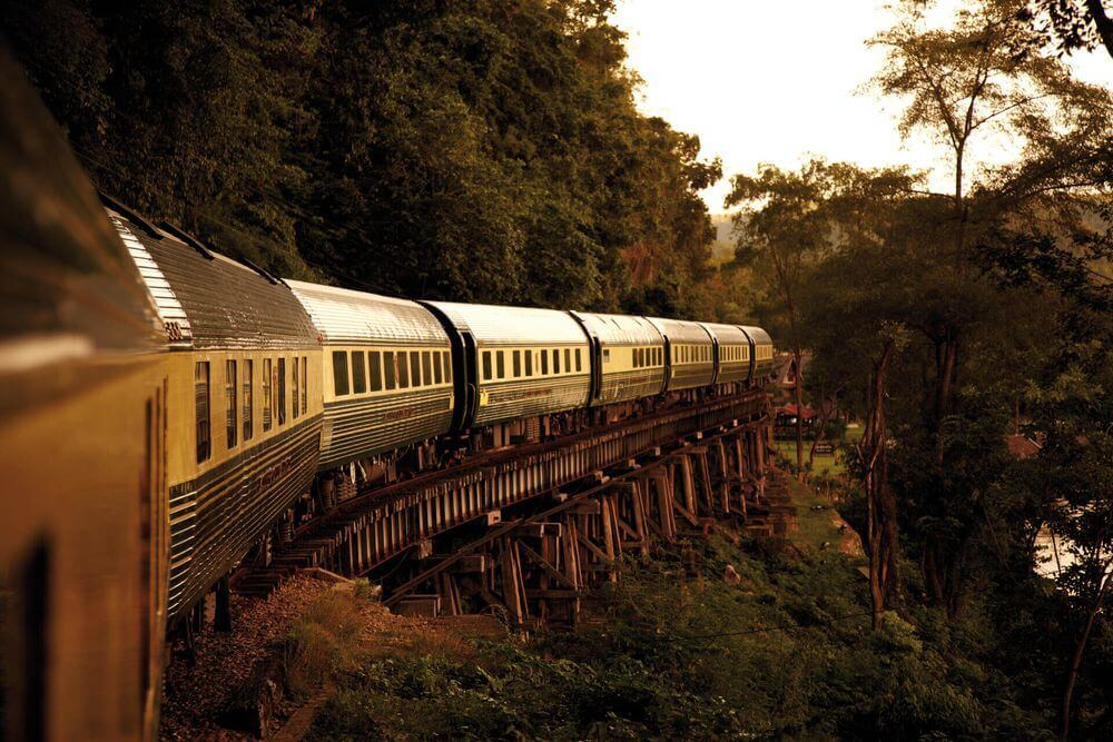 oriental express train winding through the jungle