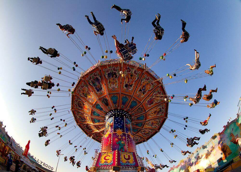 people swinging in the air on a carnival ride