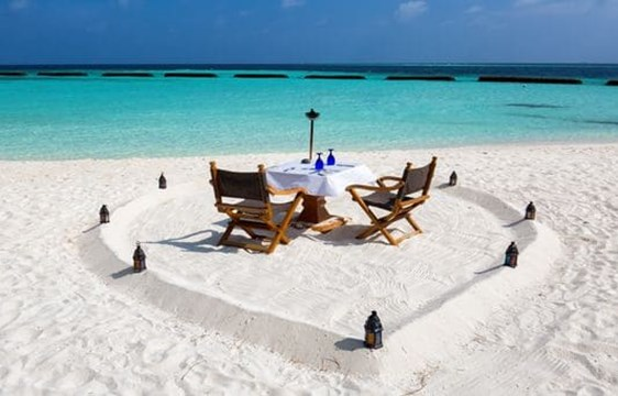 romantic private lunch on a white sandy beach in the maldives