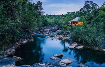 luxury tent perched over the river at Shinta Mani Wild