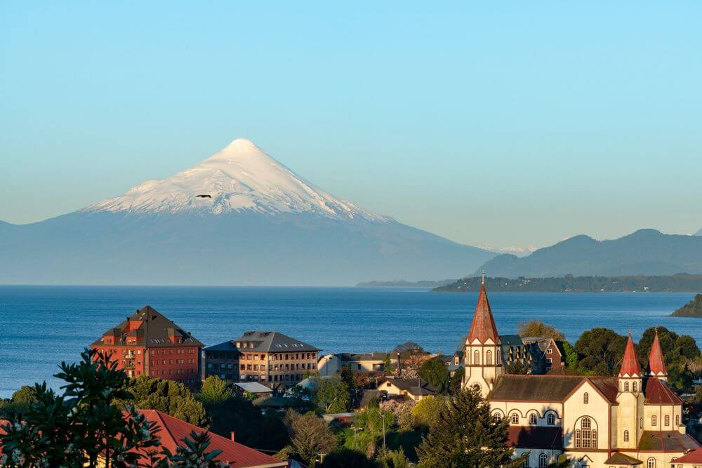 snow-capped volcanoes in the background of Puerto Varas, Chile