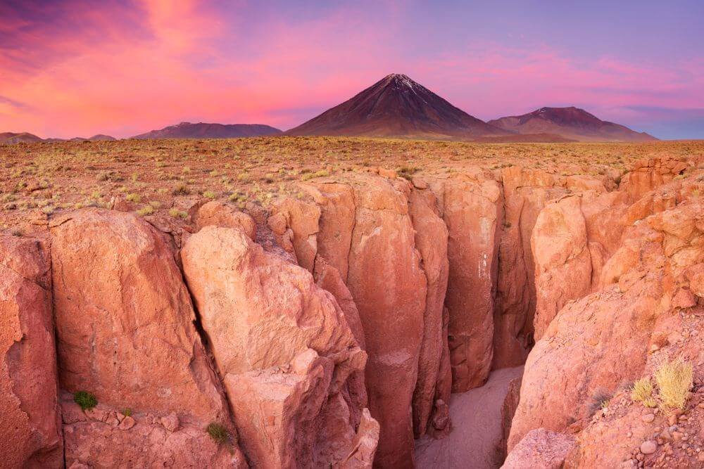 sunset over narrow canyon in atacama desert, chile