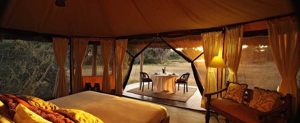 interior and view from luxury tent at siwandu camp, selous game reserve, tanzania