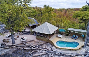 aerial view of the swimming pool and guest area at Hyena Pan Tented Camp in the Khwai Area of Botswana