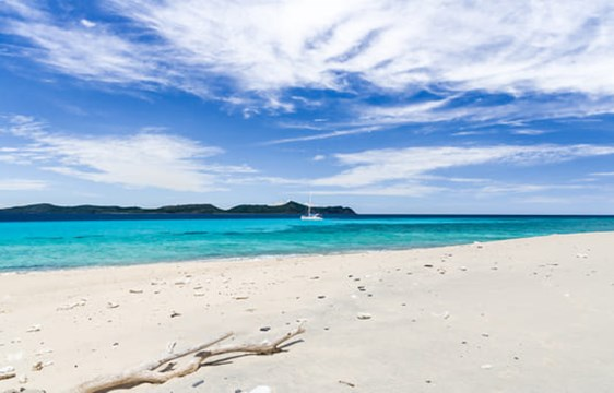 pristine white sand beach and blue waters of Madagascar