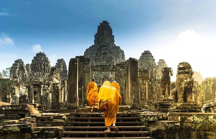 Monks walking in Bayon Temple, Angkor, Cambodia
