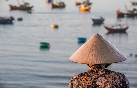 Vietnamese woman fishing in Mui Ne, Vietnam
