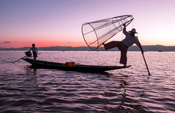 Fisherman at sunset in Inle Lake, Myanmar