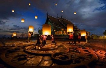 People floating lamps in Yi Peng Festival, Thailand