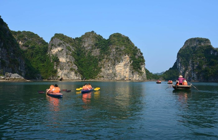 Family kayaking across Halong Bay