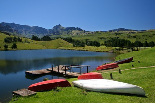 Canoes in a lake, Drakensberg Mountains