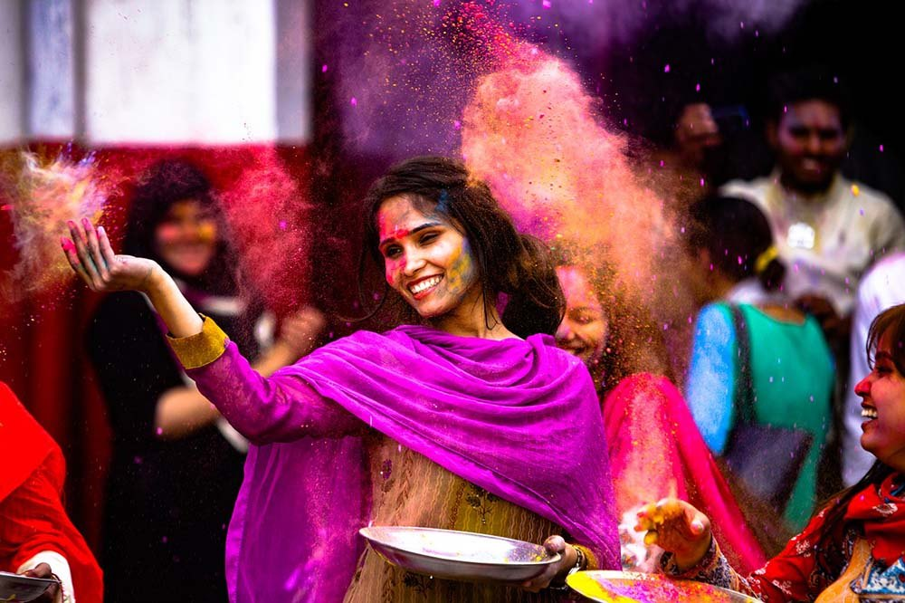 Indian lady celebrating Holi, cultural festival in Asia