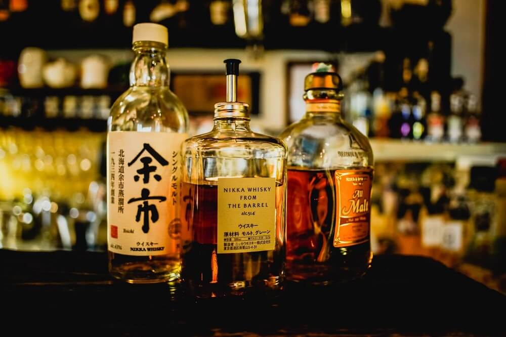 Japan Food Guide - Japanese whisky bottles on a bar