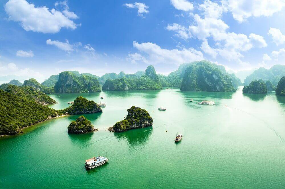 Aerial view of Ha Long Bay cruises and karsts in Vietnam