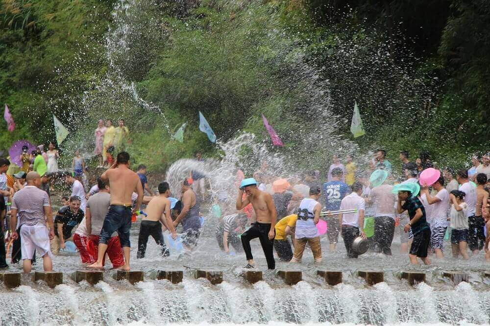thai people throwing water for songkran thai new year
