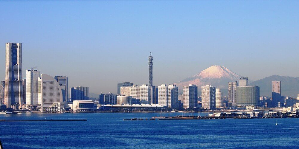 Mount Fuji rising in the background of the Yokohama city skyline