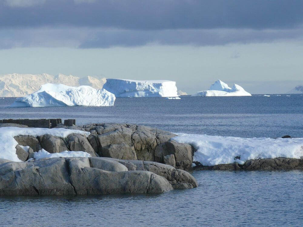 rocks and icebergs in the southern ocean antarctica