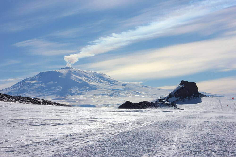 mount erebus volcano steaming and covered in snow
