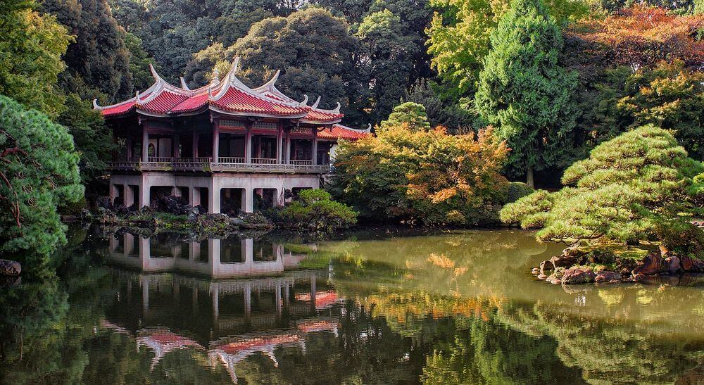 japanese temple overlooking a serene garden and pond in Japan