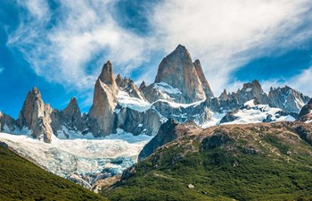 snowy rocky peaks surrounded by greenery in Patagonia Argentina
