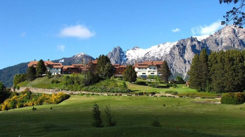Llao Llao resort surrounded by trees and mountains in Bariloche Argentina