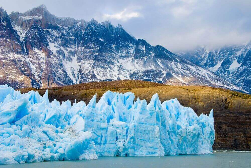 glittering glaciers surrounded by snowy mountains patagonia