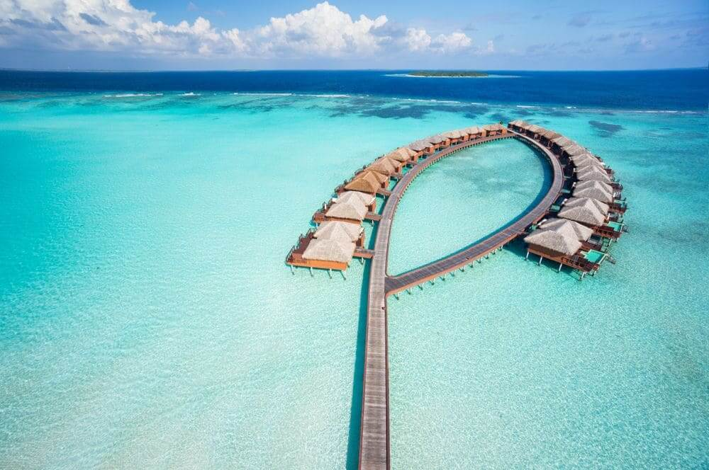 luxury overwater villas in the turquoise waters of the maldives