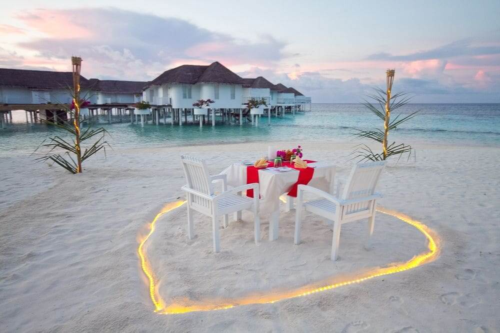 romantic private candelit dinner on the beach in the maldives