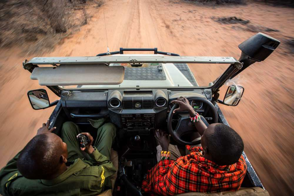 A Samburu guide and ranger lead the way on a rhino tracking experience at Saruni Rhino, Kenya