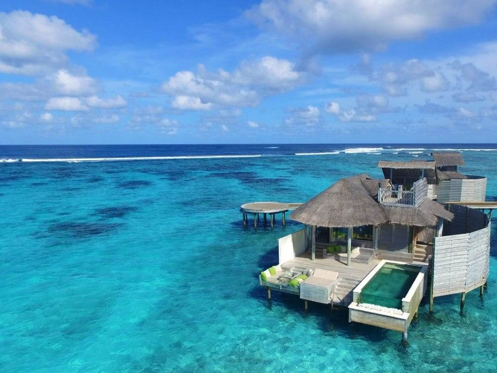overwater villas with private pool at six senses laamu maldives