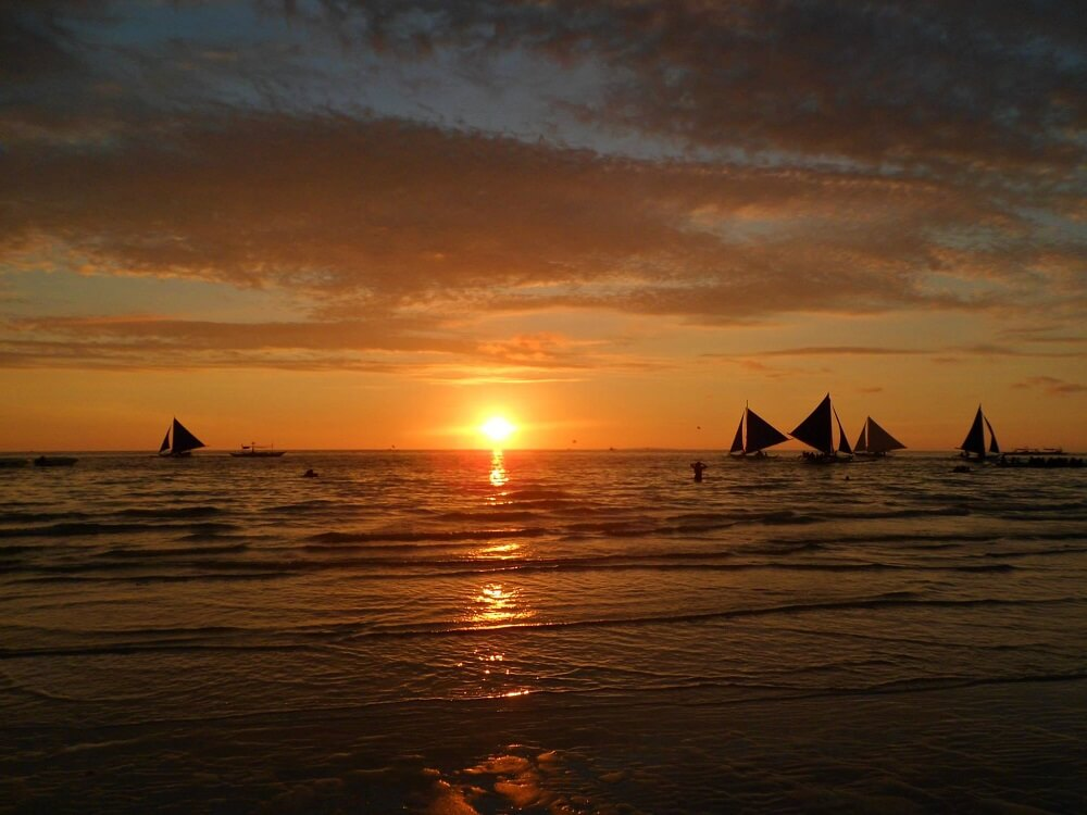 Sunset on White Beach on Boracay Island in the Philippines
