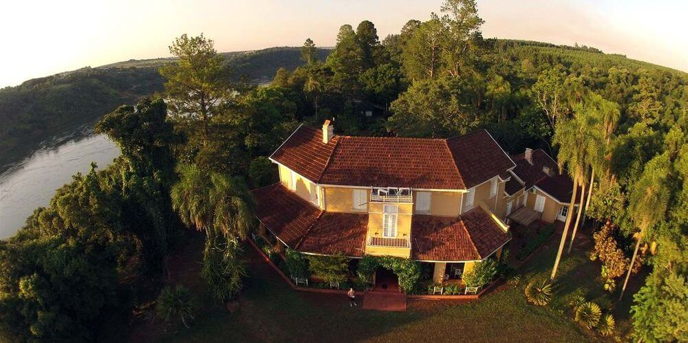 aerial view of posada puerto pemberg surrounded by jungle at iguazu falls argentina