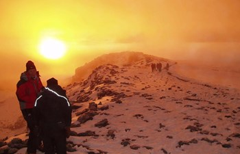 Trekking to the summit of Mount Kilimanjaro in the snow in Tanzania