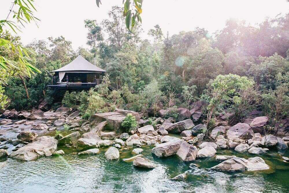 luxury tent set over the river at shinta mani wild