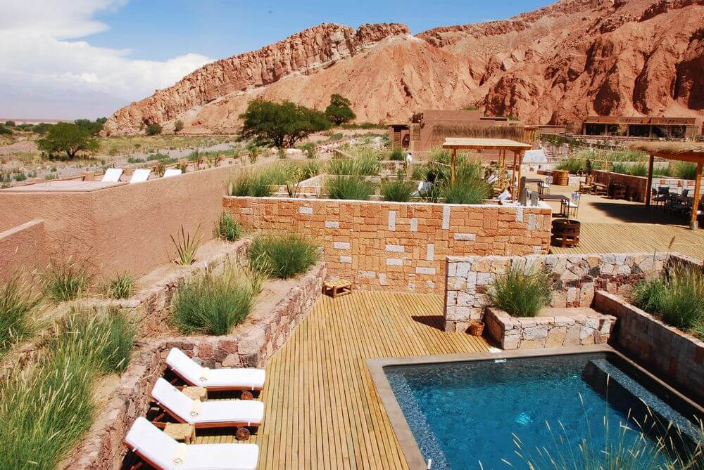 outdoor swimming pool surrounded by desert landscape at Alto Atacama, Chile