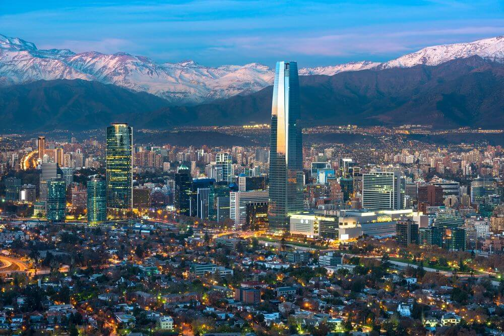 Aerial view of santiago city skyline with snow-capped mountains in the background
