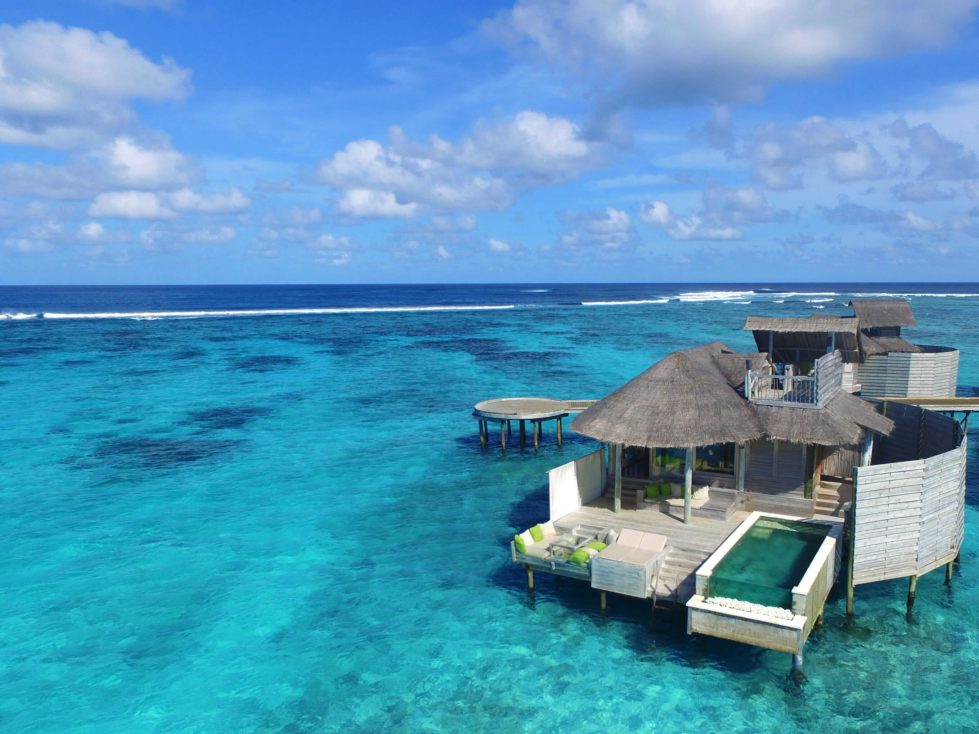 aerial view of an overwater villa at Six Senses Laamu, Maldives