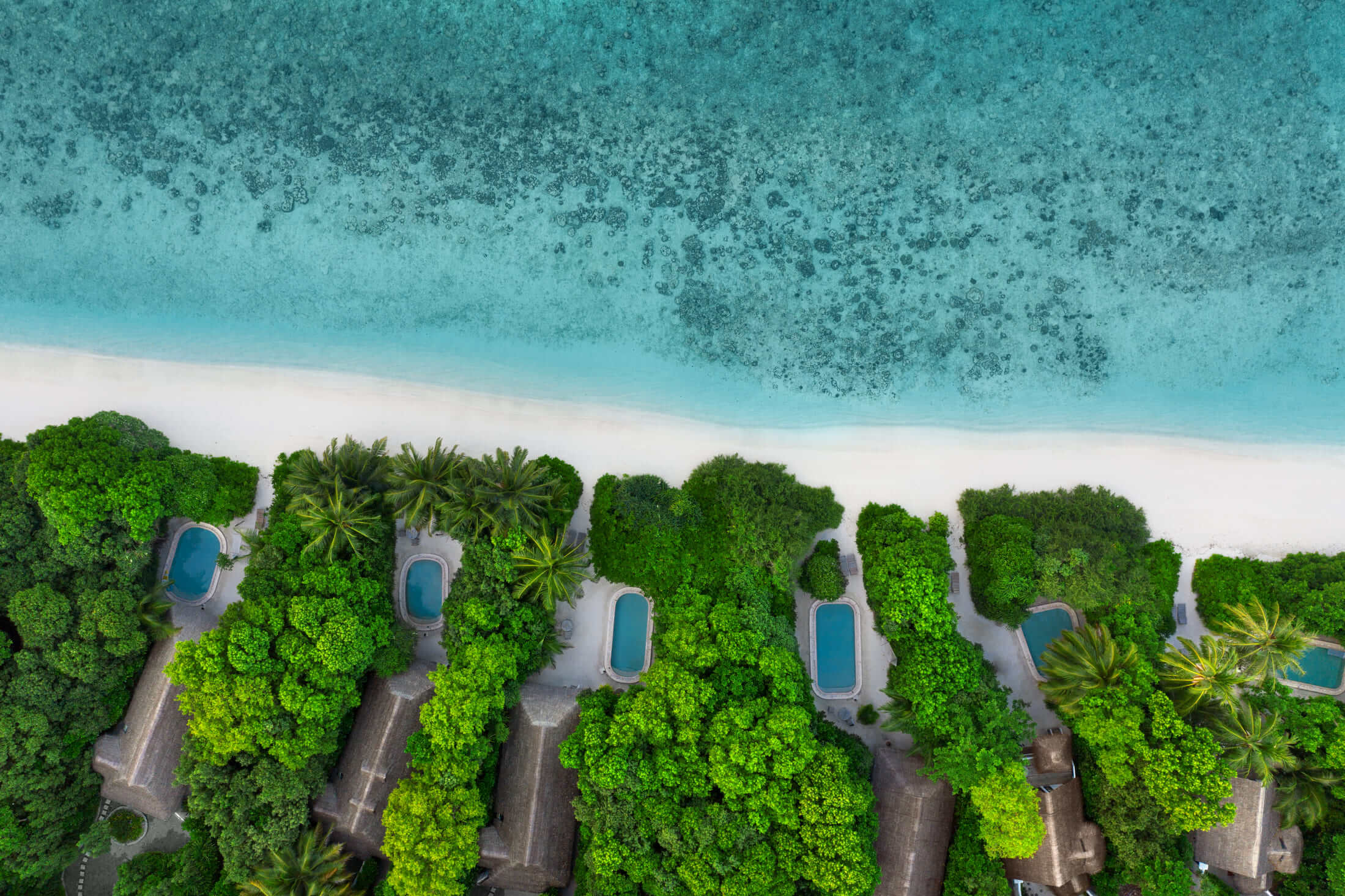 aerial view of beachside villas at Soneva Fushi Maldives