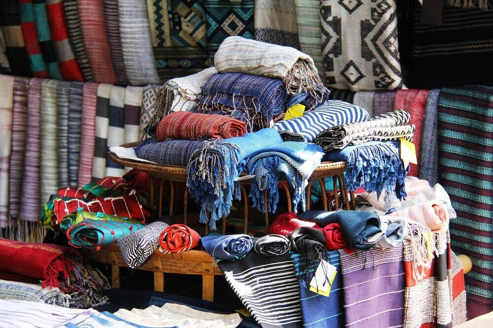 Traditional handicrafts like scarves at a market in Luang Prabang Laos
