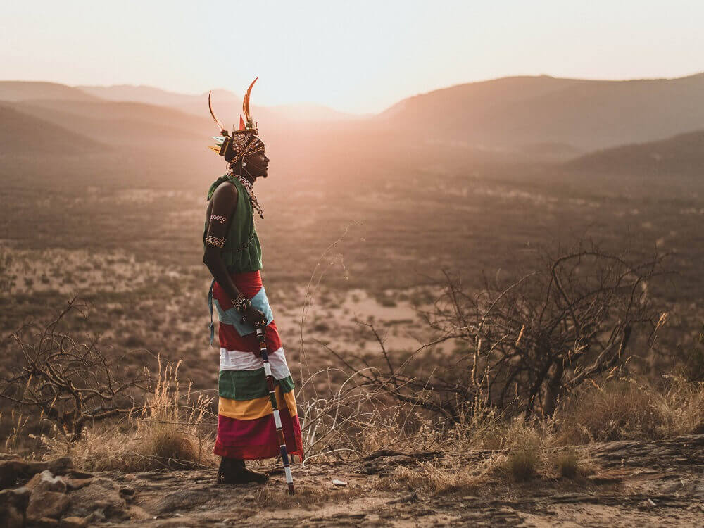 Samburu Warrior with sunset landscape in Kenya