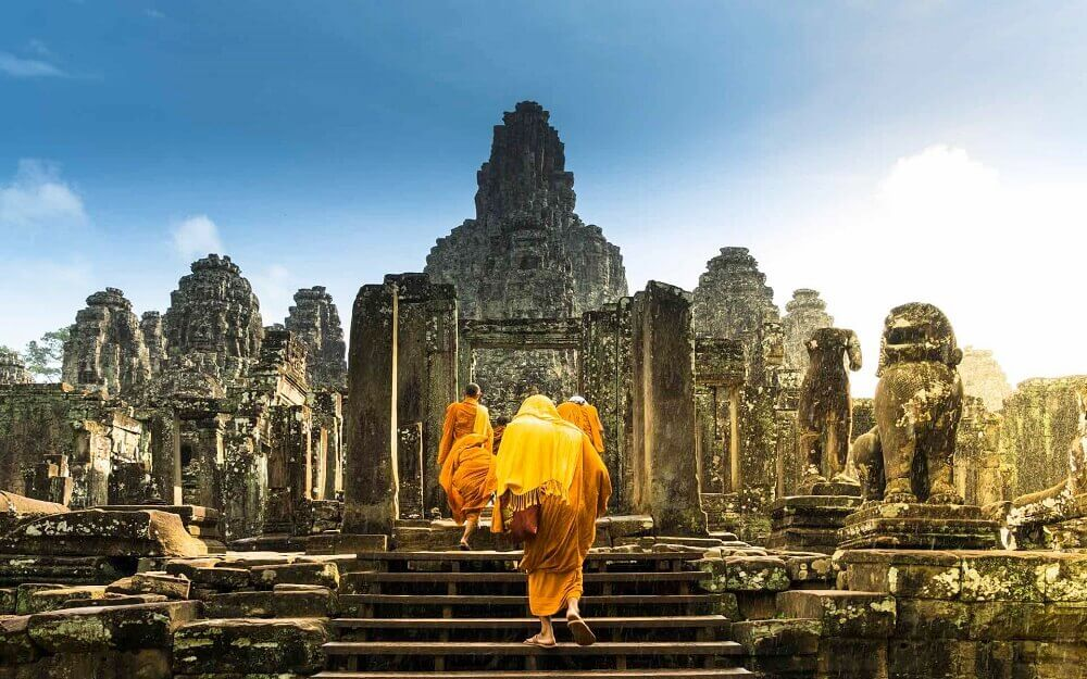 Monks in ancient Bayon temple in Angkor Cambodia