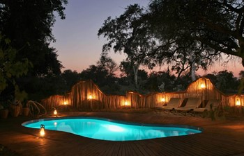 Pom Pom Camp - swimming pool at night
