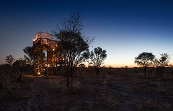 Skybeds platform illuminated at sunset in the Khwai Area, Botswana